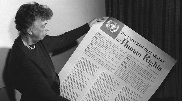 Universal-Declaration-of-Human-Rights.jpg  Eleanor Roosevelt holding poster of the Universal Declaration of Human Rights (in English), Lake Success, New York. November 1949.  FDR Presidential Library & Museum